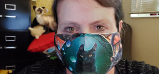 Wearing my new cat mask. Click on image to view larger size in a new window.
